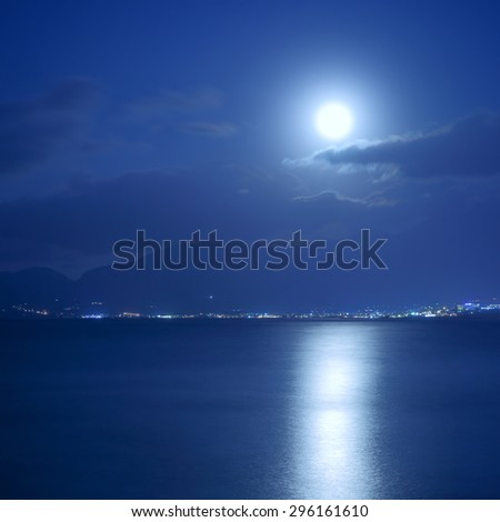 Full moon over sea and moon-glade, Crete Island, Greece - stock photo