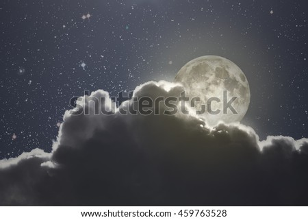 Full moon rises over a cloud on a starry night (used part of a NASA photo for the stars) - stock photo