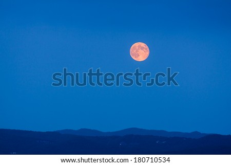 Full Moon Rising at Blue Hour - stock photo