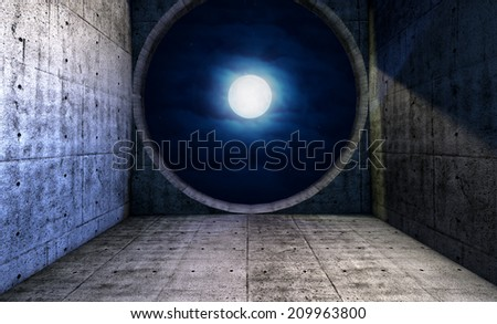 Full moon seen through a round window opening in concrete room, concept for freedom and opportunity  - stock photo