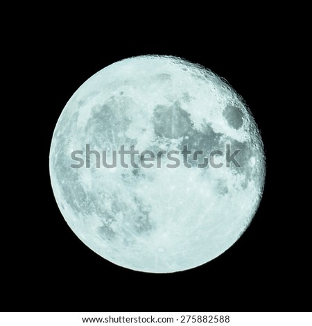 Full moon seen through a telescope image taken with my own telescope  no NASA images used - cool cold tone - stock photo