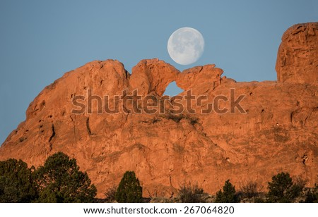 Full Moon Setting over Kissing Camels - stock photo