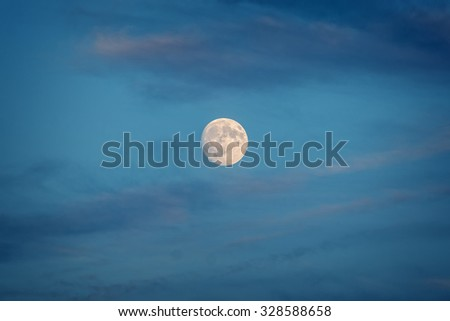 Full moon with clouds - stock photo