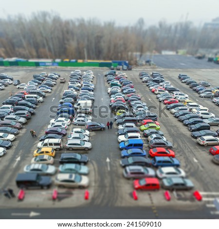 Full of car parked in a public parking lots. Tilt-shift effect - stock photo