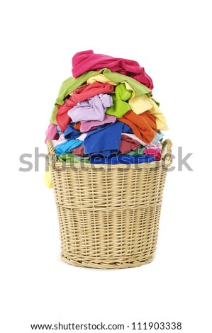 Full of colorful shirts in a wicker basket - stock photo