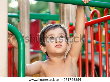 Full of emotion 3-4 years boy playing on the playground - stock photo