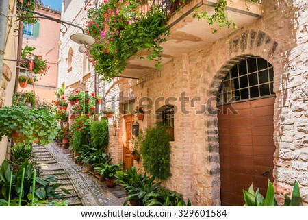Full of flower street in small town in Italy, Umbria - stock photo