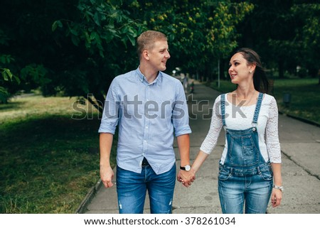 full of love stylish beautiful young  couple on background of gr