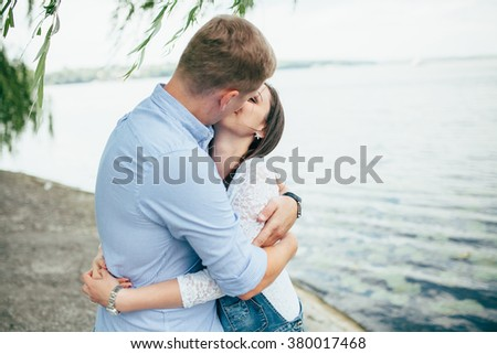 full of love stylish beautiful young  couple on background of ground