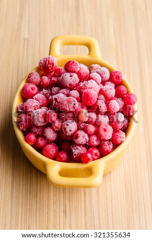 Full of vitamins and healthy frozen cranberries.  - stock photo