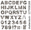 Full old metal alphabet letters, digits and punctuation marks isolated on white - stock photo