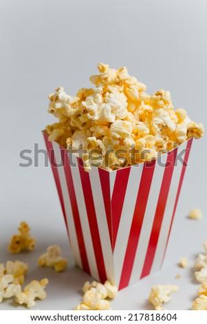 Full popcorn in classic popcorn box - stock photo