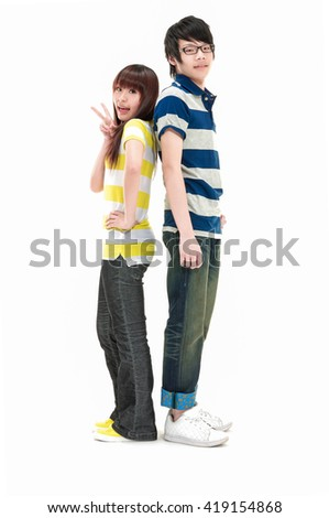 Full Portrait of a romantic young couple standing together over - stock photo