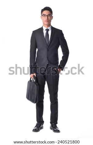 Full Portrait of a successful young business man carrying a suitcase  - stock photo