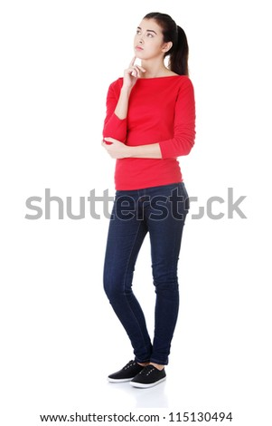 Full portrait of a working woman thinking and looking up - stock photo