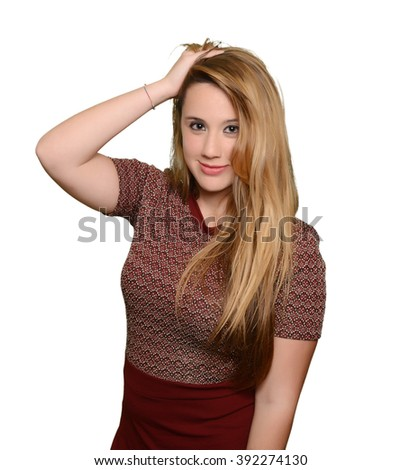 Full portrait of caucasian blonde girl touching her head - stock photo