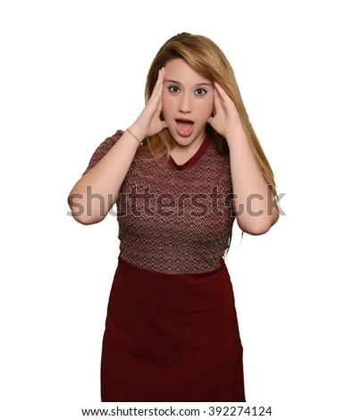 Full portrait of caucasian blonde girl touching her head and surprised - stock photo