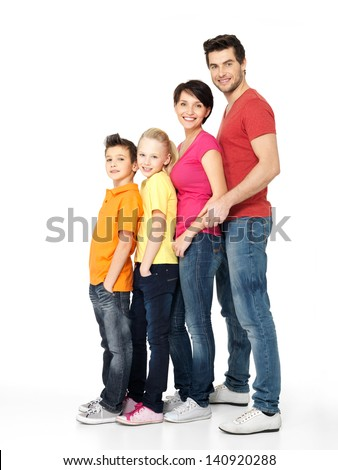 Full portrait of happy young family with two children standing together in line - isolated on white background - stock photo