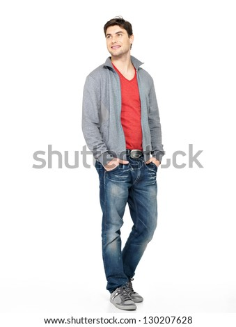 Full portrait of smiling happy handsome man in grey jacket, blue jeans. Beautiful guy standing  isolated on white background looking away