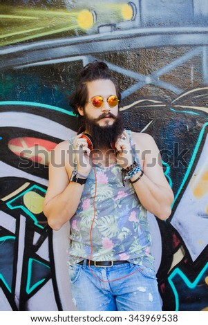 Full portrait of stylish man,lifestyle portrait of hipster man,cool beard.Mans hairstyle.haircut,hairdresser.Stylish man  with cool hairstyle,wall,big size image.Happy active,NYC street,California - stock photo