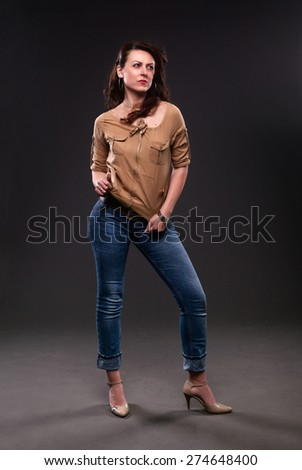 Full portrait of stylish woman in fashion jeans posing. - stock photo