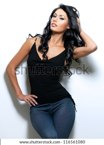 Full portrait of the woman with beauty long brown hair - posing at studio - stock photo