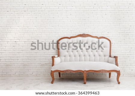 full portrait of White classical style sofa on white brick wall with copy space