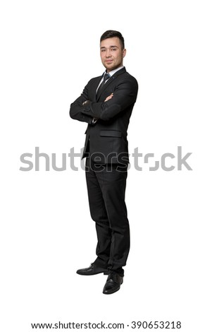 Full portrait of young business man, arms crossed his chest, isolated on a white background - stock photo