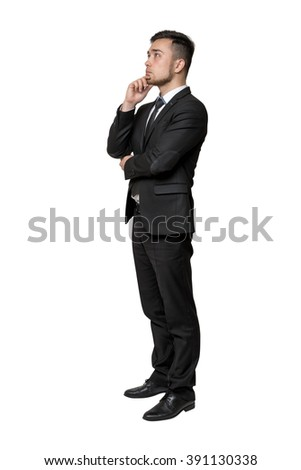 Full portrait of young man in business suit, thinking about something, isolated on a white background - stock photo