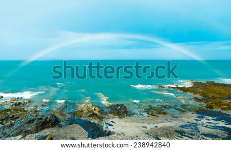 Full rainbow over sea in Malahide, Republic of Ireland, Europe - stock photo
