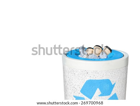 Full recycle bin filled to the top with empty plastic water bottles, paper coffee cups. Heavy rough texture stone trash can, blue recycling logo. Isolated on white. Copy space. Horizontal composition  - stock photo