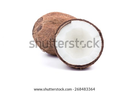 Full ripe coconut with a broken half on a white background