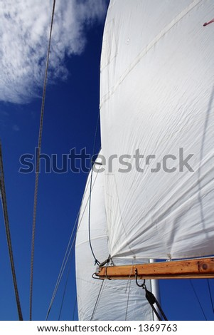 full sail and big blue sky - stock photo
