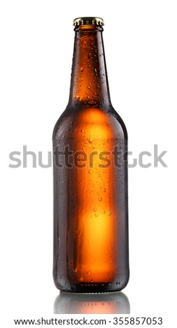 Full, sealed brown bottle of dark beer with drops. Semigloss appearance, clipping paths