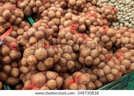 Full shells with potato in supermarket. World consumption problem. - stock photo