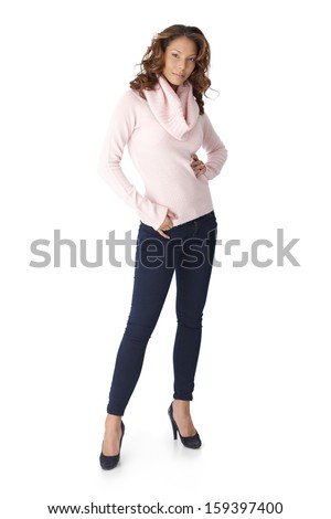 Full size photo of confident young casual woman over white background.