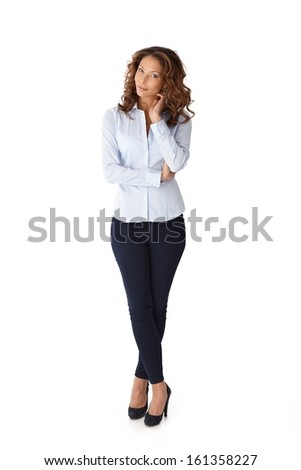 Full size portrait of pretty casual woman over white background.