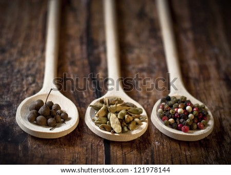 full spoons of spices - stock photo