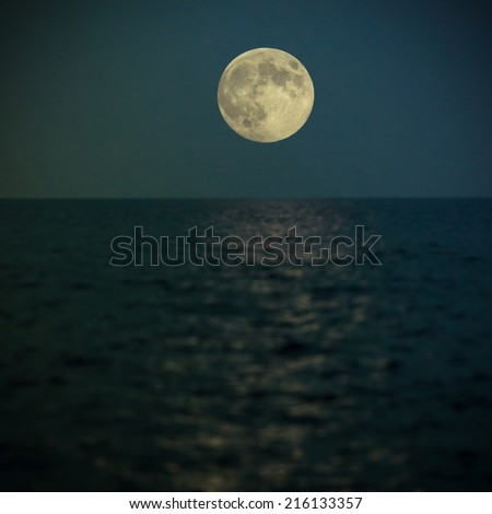 full super moon under the sea getting the light reflection on the water