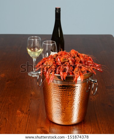full tail of rever lobsters with wine and glasses - stock photo