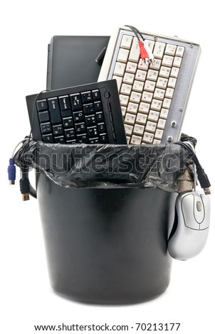 Full trash of used computer hardware. Notebook, keyboards, cables... Isolated on white
