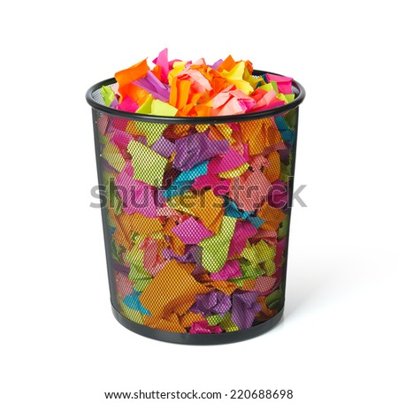 Full trash with colored paper on white background. File contains a path to isolation. - stock photo