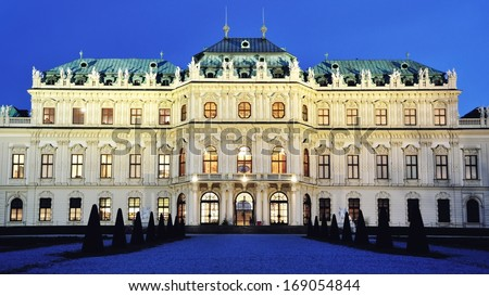 Full view of a baroque Upper Palace in historical complex Belvedere, Vienna, Austria at night in winter. It is a popular touristic attraction with famous museum and beautiful park - stock photo