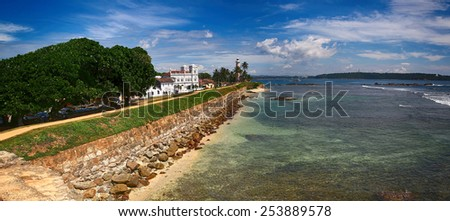 Full view of the sea port with a lighthouse - stock photo