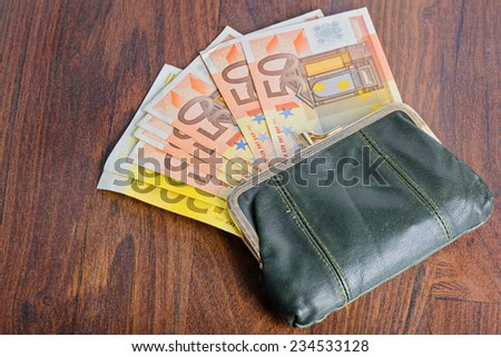 Full wallet on the table - stock photo