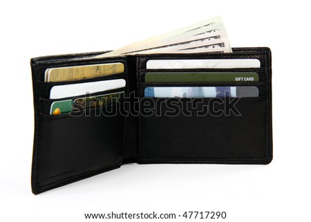 full wallet with money and gift cards; white background shallow focus - stock photo