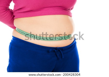 Full woman measures the stomach tape, isolated on white background - stock photo