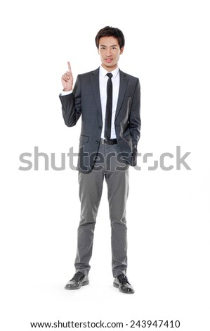 Full young business man in a suit pointing with his finger  - stock photo