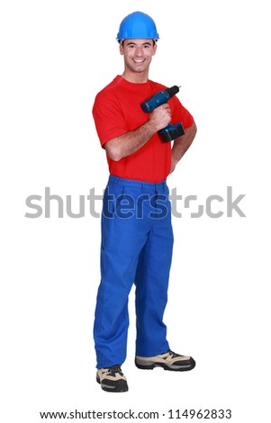 fullbody portrait of craftsman holding cordless drill