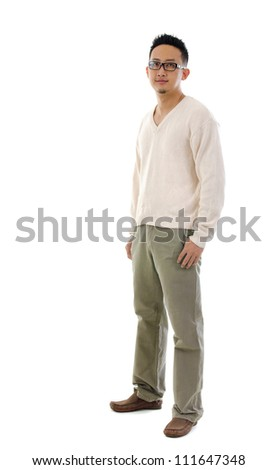Fullbody 30s Southeast Asian man standing over white background - stock photo